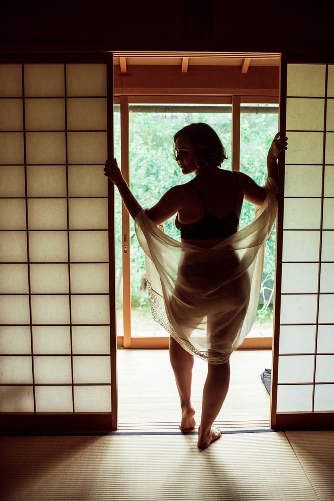 Kitsap WA Boudoir Photography, shadowed image of woman standing in a doorway
