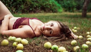 Woman laying in grass with apples, Kitsap WA Boudoir Photography